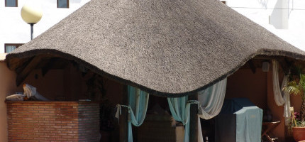 Tropical thatched roof in cylindrical and turned wood